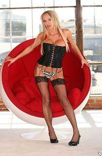 Shyla Ryan in black corset and stockings