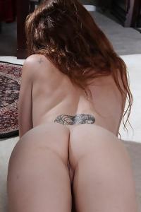 Teen Redhead Shows Her Tattoos