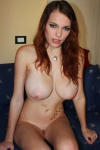 Cute busty redhead Samantha
