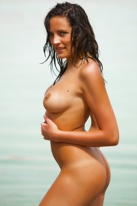 Naked Hottie Having Fun By The Sea