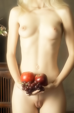 Blonde sweetie caresses naked body with fruits.