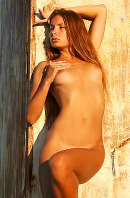 Totally naked babe wanders the ruins.