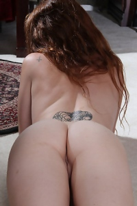 Teen Redhead Shows Her Tattoos