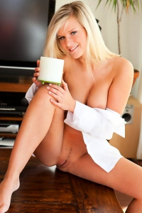 Busty blonde Miela undressing