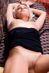 Adorable blonde babe with hairless pussy
