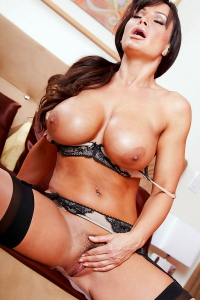 Lisa Ann Caresses Her Breasts