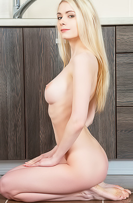 Beautiful blonde gets naked on the kitchen floor